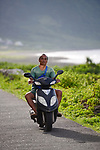 Orchid Island (蘭嶼), Taiwan -- Local riding a scooter along the eastern shoreline.