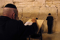 "An Orthodox Jew pries ""Selihot"" or special prayers for forgiveness at the Western Wall in the Old City of Jerusalem, September 10,2002. According to Jewish tradition in this prayers the Jew asks the Lord for forgiveness for all sins and omissions in connection with religious observance, during the hours after midnight till the daybreak.  Tradition marks the days after Rosh Hashanah and before the Day of Atonement, Yom Kippur, as most appropriate to ask for forgiveness. Photo by Quique Kierszenbaum"