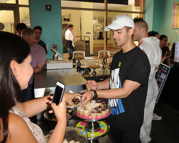 MIAMI, FL - JUNE 11: Joe Jonas of DNCE attends Radio Station Y-100's cup cake and toothbrush party at LA Sweets on June 11, 2016 in Miami, Florida. Credit: mpi04/MediaPunch