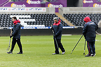 Groundsmen see to the pitch during the Swansea City Training at the Liberty Stadium, Swansea, Wales, UK. Thursday 01 March 2018