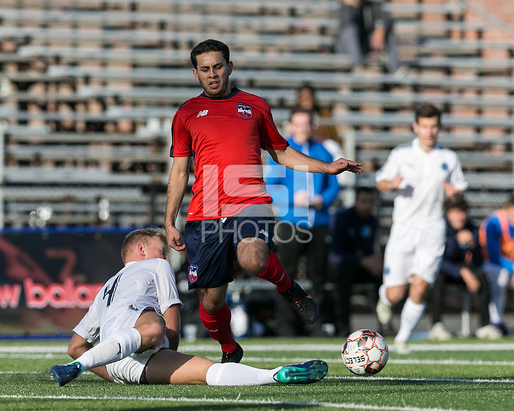 Malden, Massachusetts - June 3, 2018:  In a  National Premier Soccer League (NPSL) match, Brooklyn Italians (white) defeated Boston City FC (red/lbue), 6-0, at Brother Gilbert Stadium on Donovan Field.