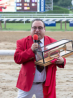 """Sam """"The Bugler"""" Grossman  is honored  by NYRA at Saratoga Race Course, Sep. 3, 2018.    On closing day of the Saratoga meet  the retirement of Grossman  is celebrated after 25 years of service.  (Bruce Dudek/Eclipse Sportswire)"""