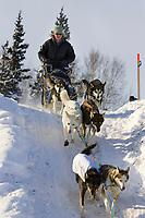 Melanie Goulds team mushes out of McGrath Chkpt onto Kuskokwim River 2006 Iditarod Interior AK Winter