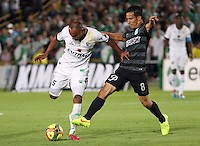 BOGOTA -COLOMBIA, 1 -SEPTIEMBRE-2014. Elvis Gonzalez ( I) de La Equidad  F.C. disputa el balón con Elvis Gonzalez ( D ) del Atletico Nacional  durante partido de la  septima  fecha  de La Liga Postobón 2014-2. Estadio Nemesio Camacho El Campin . / Elvis Gonzalez (L) of Equidad FC    fights for the ball with Diego Arias  of Atletico Nacional    during match of the 7th date of Postobon  League 2014-2. El Campin  Stadium. Photo: VizzorImage / Felipe Caicedo / Staff