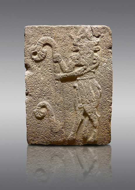 Picture & image of Hittite monumental relief sculpted orthostat stone panel from Water Gate Basalt, Karkamıs, (Kargamıs), Carchemish (Karkemish), 900-700 B.C. Anatolian Civilisations Museum, Ankara, Turkey. Bull-man holding the trunk of the tree. The waist-down part of the figure is in the form of a bull. <br /> <br /> On a gray background.