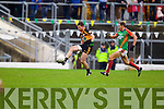 Barry Shanahan Austin Stacks in action against Sean O'Sullivan Mid Kerry in the Kerry Senior County Football Final at Fitzgerald Stadium on Sunday.