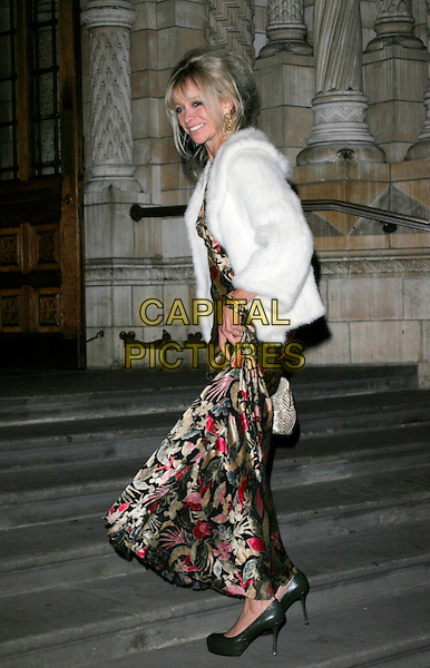 JO WOOD .Attends the Save the Children Festival of Trees at the Natural History Museum,  London, England, USA, December 9, 2008..Full length white fur coat jacket patterned print dress pink green gold floral long maxi bag grey gray heels shoes steps .CAP/AH.©Adam Houghton/Capital Pictures