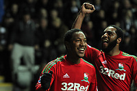 Saturday 17 November 2012<br /> Pictured L-R: Jonathan de Guzman of Swansea celebrating his goal with team mate Kemy Agustien.<br /> Re: Barclay's Premier League, Newcastle United v Swansea City FC at St James' Park, Newcastle Upon Tyne, UK.