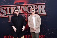 "LOS ANGELES - JUN 28:  Kyle Dixon, Michael Stein at the ""Stranger Things"" Season 3 World Premiere at the Santa Monica High School on June 28, 2019 in Santa Monica, CA"