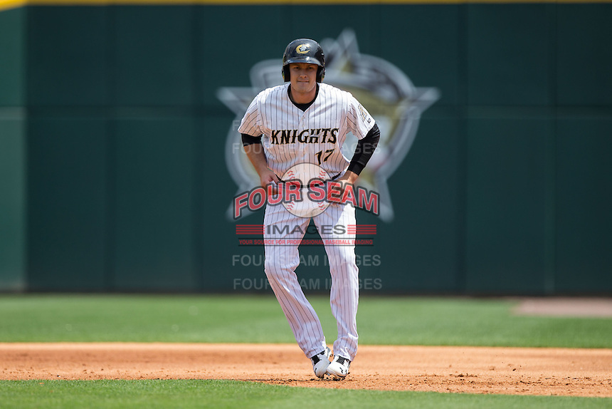 Jason Coats (17) of the Charlotte Knights takes his lead off of first base against the Gwinnett Braves at BB&T BallPark on May 22, 2016 in Charlotte, North Carolina.  The Knights defeated the Braves 9-8 in 11 innings.  (Brian Westerholt/Four Seam Images)