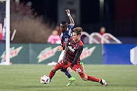 Foxborough, Massachusetts - April 27, 2016:  The New England Revolution (blue and white) tied with the Portland Timbers  (red and black) 1-1 in a Major League Soccer (MLS) match at Gillette Stadium.