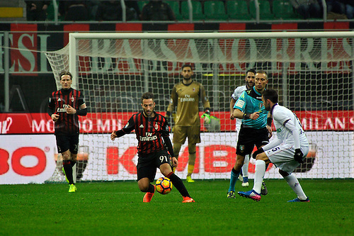 February 19th 2017, San Siro, Milan, Italy; Andrea Bertolacci of Milan challenged by Milan Badelj during  Serie A football, AC Milan versus Fiorentina;