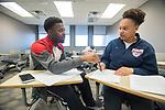 Nickolas Jones and Canaya Jones in Angela Green's LIBA 102 class in Lamar.  Photo by Kevin Bain/University Communications Photography