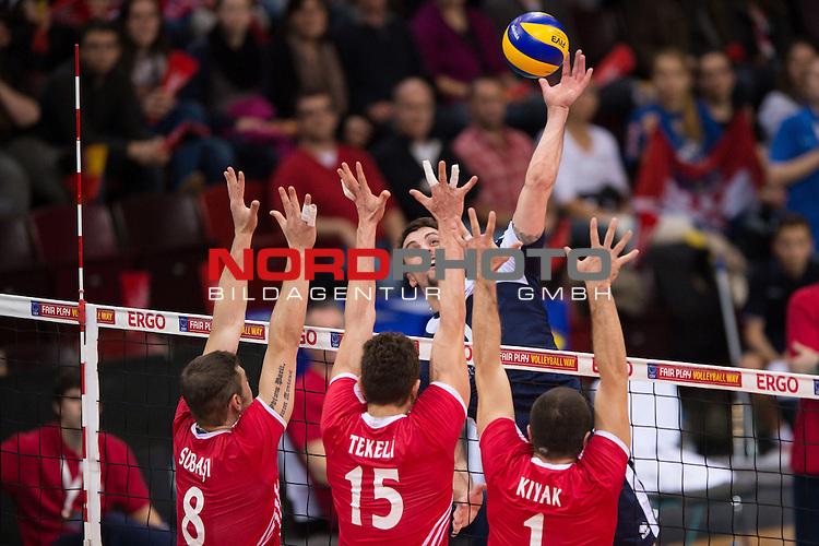 04.01.2014, MHP Arena, Ludwigsburg<br /> Volleyball, Qualifikation WM 2014, T&uuml;rkei / Tuerkei vs. Kroatien<br /> <br /> Block  / Dreierblock Burutay Subasi (#8 TUR), Resul Tekeli (#15 TUR), Ulas Kiyak (#1 TUR) - Angriff Ivan Raic (#6 CRO)<br /> <br />   Foto &copy; nordphoto / Kurth