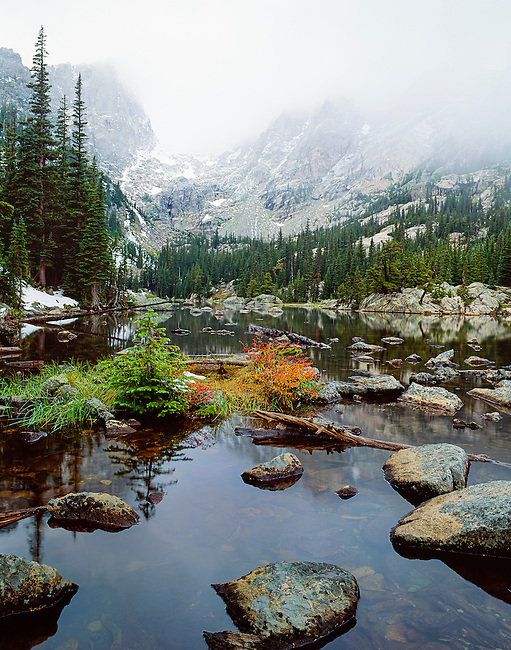 mists shroud peaks on an autumn morning at Dream Lake in Rocky Mountain National Park, Colorado, USA