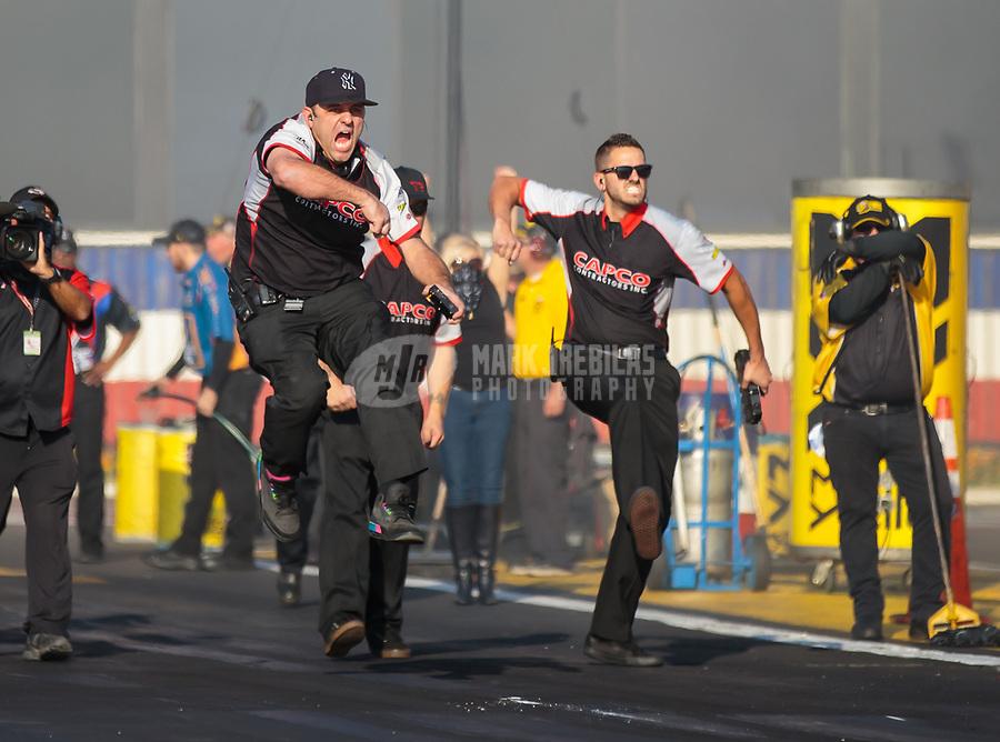 Nov 11, 2018; Pomona, CA, USA; Crew members for NHRA top fuel driver Steve Torrence celebrate during the Auto Club Finals at Auto Club Raceway. Mandatory Credit: Mark J. Rebilas-USA TODAY Sports