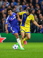Loic Remy of Chelsea and Omri Ben Harush of Maccabi Tel-Aviv during the UEFA Champions League match between Chelsea and Maccabi Tel Aviv at Stamford Bridge, London, England on 16 September 2015. Photo by David Horn.