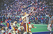 Washington Redskins running back Gerald Riggs (37) celebrates after scoring the first of his two touchdowns against the Buffalo Bills during Super Bowl XXVI in Minneapolis, Minnesota on January 26, 1992.  The Redskins won the game and the World Championship 37 - 24.<br /> Credit: Howard L. Sachs / CNP