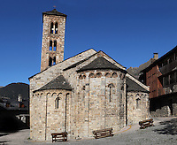 Low angle view of Santa Maria de Taull Church, 1123, consecrated by Ramon Guillem, the bishop of Roda, Taull, Province of Lleida, Catalonia, Spain. The church was built with three naves, each ending with an apse which cornice is decorated with Lombard arches. The four storeys bell tower is the oldest part and it is also decorated with Lombard arches and mullioned windows. The church was heavily renovated in the 18th century. Santa Maria de Taull Church is part of the Catalan Romanesque churches of the Vall de Boí which were declared a World Heritage Site by UNESCO in November 2000. Picture by Manuel Cohen