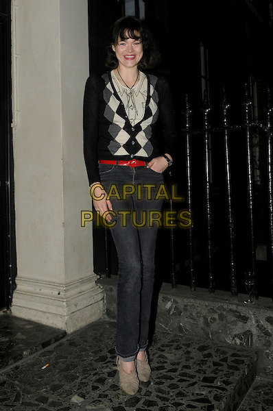 Jasmine Guinness spotted in Soho, London, England..17th February 2012.full length black grey gray jeans denim rd belt white argyle top jumper sweater .CAP/IA.©Ian Allis/Capital Pictures.