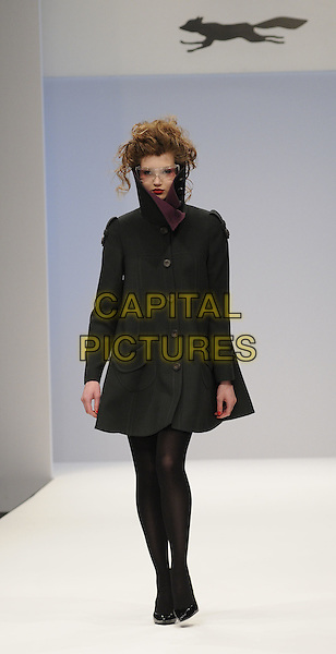 MODEL.The Paul Costelloe a/w show, London Fashion Week Day 1, BFC Tent, natural History Museum, London, England..February 20th, 2009.LFW full length runway catwalk black coat tights jacket collar sunglasses shades .CAP/CAN.©Can Nguyen/Capital Pictures.