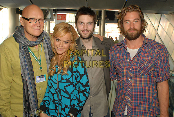 "ALLAN MOYLE (DIRECTOR), TARYN MANNING, WES BENTLEY & SCOTT SPEEDMAN.""Weirdsville"" Premiere screening during the 2007 Toronto International Film Festival, Toronto, Canada..September 12th, 2007.half length brown suit jacket beard facial hair blue turquoise zip up jacket black pattern glasses scarf .CAP/ADM/BPC.©Brent Perniac/AdMedia/Capital Pictures."
