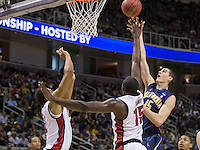 March 21st, 2013: California's David Kravish shoots over UNLV's Anthony Bennett and Khem Birch at HP Pavilion, San Jose, California. California defeated UNLV 64 - 61
