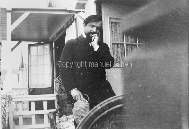 Claude Debussy, 1862-1918, French composer, in Pourville, Northern France, photograph taken 1904. Copyright © Collection Particuliere Tropmi / Manuel Cohen