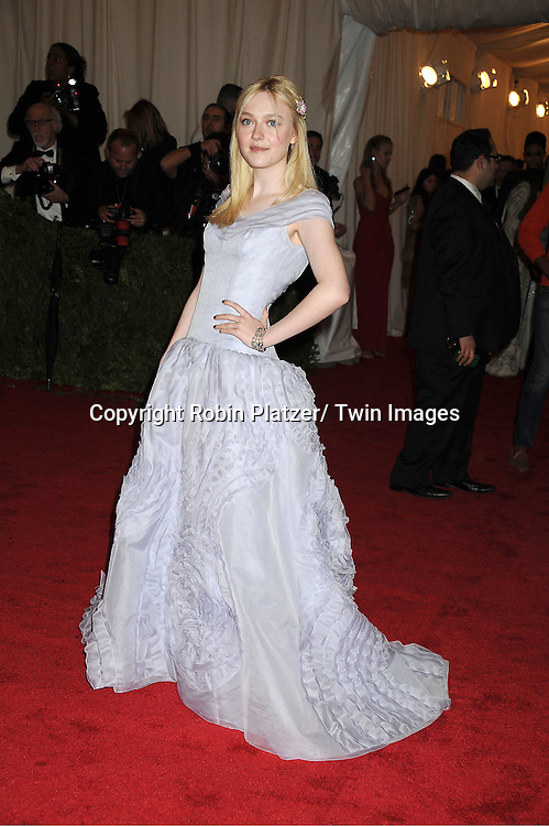 "Dakota Fanning attends the Costume Institute Gala Benefit celebrating ""Schiaparelli and Prada: Impossible Conversations"".an exhibition at the Metropolitan Museum of Art in New York City on May 7, 2012."