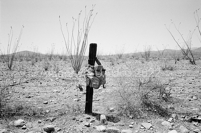 Douglas, Arizona<br /> May 4, 2008<br /> <br /> West of Douglas new border fencing marks the US/Mexican border. The vast majority of the Arizona/Mexican border is now marked by vehicle barrier or high fencing yet immigrants still seem to scale the fence in leave trails of backpacks and human debris in their wake.