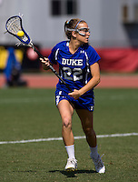 Virginia Crotty (22) of Duke brings the ball upfield during the ACC women's lacrosse tournament semifinals in College Park, MD.  North Carolina defeated Duke, 14-4.