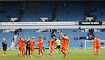 Dundee Utd applaud their fans as the home support trudge off