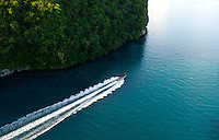 Aerial of the Rock Islands in the late afternoon, a boat returning from a dive trip Palau, <br /> Micronesia