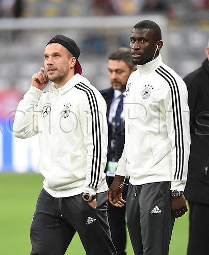 29.03.2016. Munich, Germany. International soccer match between Germany and Italy, at the Allianz Arena.  Lukas Podolski (Ger), Antonio Rudiger (Ger)