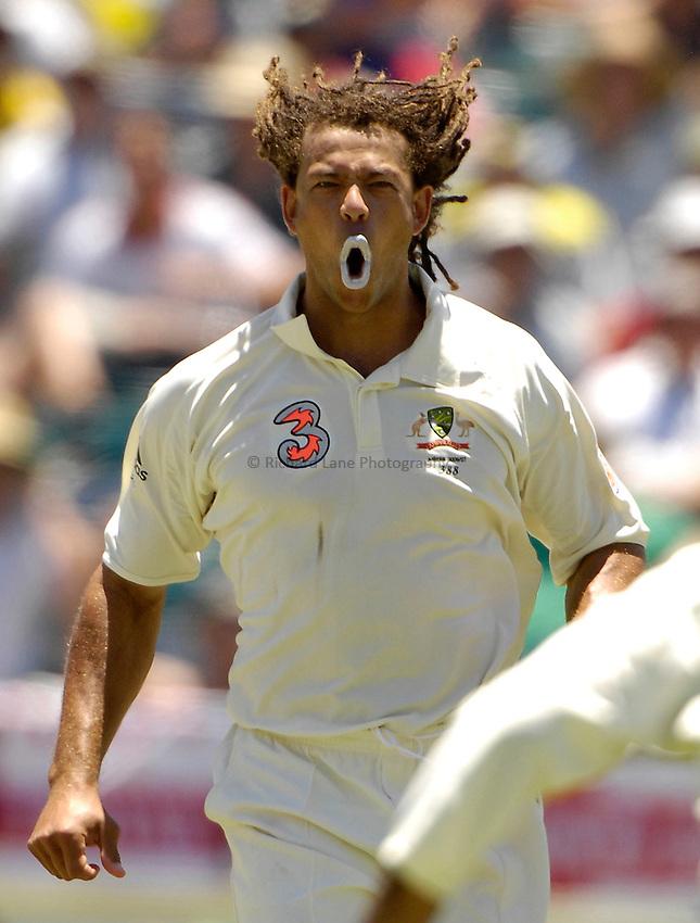 Photo: Steve Holland..Australia v England. 3 mobile Test Series, The Ashes 2006/07, 3rd Test. 15/12/2006..Australia's Andrew Symonds celebrates the wicket of Andrew Flintoff.