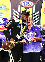 Jul 10, 2016; Joliet, IL, USA; NHRA top fuel driver Antron Brown (left) celebrates with sponsor Terry Chandler after winning the Route 66 Nationals at Route 66 Raceway. Mandatory Credit: Mark J. Rebilas-USA TODAY Sports