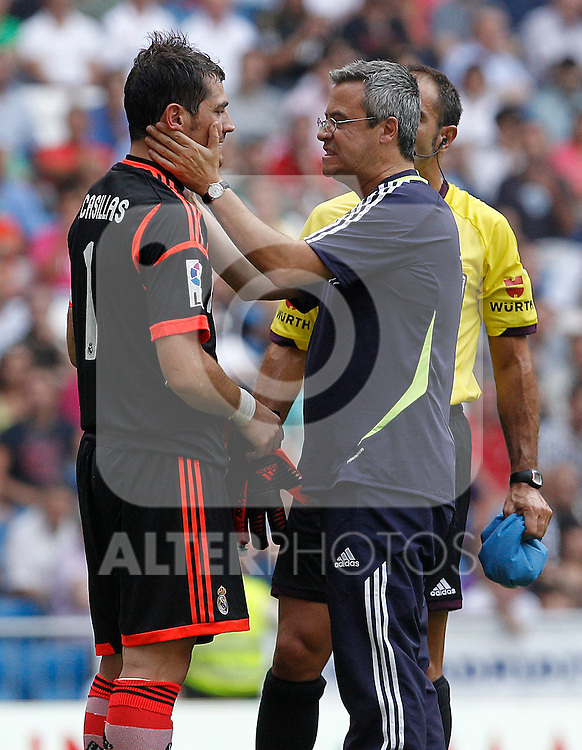 Real Madrid's Iker Casillas (l) injured in presence the doctor and spanish referee Mr. Carlos Delgado Ferreiro (c) during La Liga match.August 19,2012. (ALTERPHOTOS/Acero)