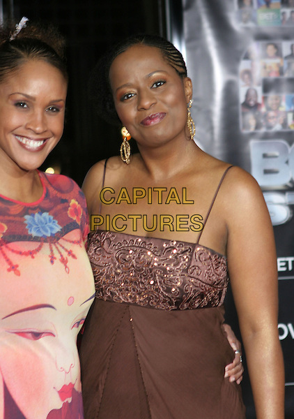 NIKKI CRAWFORD & TEMPESTT BLEDSOE.25 Strong: The BET Silver 25th Anniversary Special - Arrivals held at the Shrine Auditorium, Los Angeles, California..October 26th, 2005.Photo: Zach Lipp/AdMedia/Capital Pictures.Ref: ZL/ADM.half length brown .www.capitalpictures.com.sales@capitalpictures.com.© Capital Pictures.