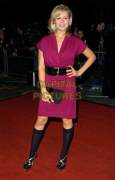 "ABI TITMUSS.Celebrity Guests attend ""Another Audience with Al Murray - Pub Landlord"" at London ITV Studios, South Bank, London, England, October 21st 2007. .full length red marron dress hand on hip black waist belt knee high socks clutch bag.CAP/CAN.©Can Nguyen/Capital Pictures"