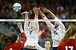 KANSAS CITY, KS - DECEMBER 14: Abby Detering #7 and Haleigh Washington #15 of Penn State University jump for a block against the University of Nebraska during the Division I Women's Volleyball Semifinals held at Sprint Center on December 14, 2017 in Kansas City, Missouri. (Photo by Tim Nwachukwu/NCAA Photos via Getty Images)