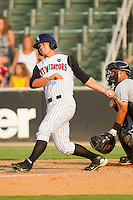 Brady Shoemaker #21 of the Kannapolis Intimidators follows through on his swing against the Hagerstown Suns at Fieldcrest Cannon Stadium August 8, 2010, in Kannapolis, North Carolina.  Photo by Brian Westerholt / Four Seam Images