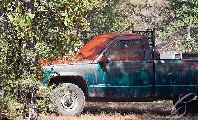 A Grimes County resident's truck sits covered in fire retardant dropped by an aerial firefighting plane.  The Texas Forest Service and national firefighting assets battled the Dyer Mill fire for a third day on  June 21, 2011.