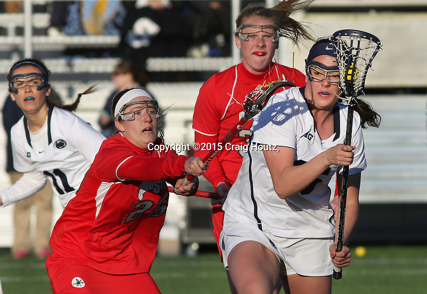 Penn State's Jenna Mosketti (25) against Ohio State's Christine easton (25), left, and Molly Wood (33), rear, on April 4, 2015. No. 12 Penn State defeated No.18 Ohio State 14-13. Photo/© 2015 Craig Houtz