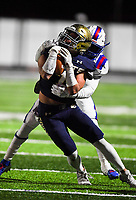 NWA Democrat-Gazette/CHARLIE KAIJO Shiloh Christian High School Micah Button (7) carries the ball as Arkadelphia High School defensive back KJ Terry (20) tackles during a Class 4A semi-final playoff football game, Saturday, December 1, 2018 at Champions Stadium at Shiloh Christian High School in Springdale.