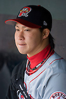 Junichi Tazawa #16 of the Portland Sea Dogs watches the action from the dugout at Waterfront Park May 12, 2009 in Trenton, New Jersey. (Photo by Brian Westerholt / Four Seam Images)