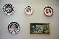 Switzerland. Canton Ticino. Barbengo. «San Ambrogio» church. Decorations on the wall (Left to right, top to down):- A plate with the image of Pope John Paul I (Latin: Ioannes Paulus I; born Albino Luciani; 17 October 1912 – 28 September 1978) who served as Pope of the Catholic Church and sovereign of the Vatican City from 26 August 1978 to his sudden death 33 days later. His reign is among the shortest in papal history. - A plate with the image of Pope Paul VI (Latin: Paulus VI), born Giovanni Battista Enrico Antonio Maria Montini; 26 September 1897 – 6 August 1978), who reigned from 21 June 1963 to his death in 1978. Succeeding John XXIII, he continued the Second Vatican Council which he closed in 1965, implementing its numerous reforms, and fostered improved ecumenical relations with Eastern Orthodox and Protestants, which resulted in many historic meetings and agreements. - A plate with the image of Pope Saint John XXIII (Latin: Ioannes; born Angelo Giuseppe Roncalli ; 25 November 1881 – 3 June 1963) who was head of the Catholic Church and ruler of the Vatican City State from 28 October 1958 to his death in 1963 and was canonized on 27 April 2014. - A plate with the image of Pope Saint John Paul II (Latin: Ioannes Paulus II; born Karol Józef Wojtyła; 18 May 1920 – 2 April 2005) who served as Pope of the Catholic Church and sovereign of Vatican City from 1978 to 2005. John Paul II is recognised as helping to end Communist rule in his native Poland and eventually all of Europe. John Paul II significantly improved the Catholic Church's relations with Judaism, Islam, the Eastern Orthodox Church, and the Anglican Communion. He upheld the Church's teachings on such matters as artificial contraception and the ordination of women, but also supported the Church's Second Vatican Council and its reforms. He was one of the most travelled world leaders in history, visiting 129 countries during his pontificate. As part of his special emphasis on the universal call