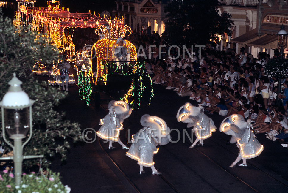 Orlando, Florida - Circa 1986. Disney World character Cinderella arrives in a pumpkin at the Main Street Electrical Parade. The Main Street Electrical Parade was created by Bob Jani and Ron Miziker, and first appeared at Disney World on June 11, 1977. Disney World is a world-renowned entertainment complex that opened October 1, 1971 in Lake Buena Vista, FL. Now known as the Walt Disney World Resort, the property covers 25,000 acres and has an annual attendance of 52.5million people.