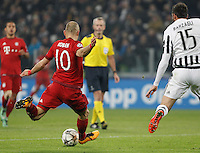 Calcio, andata degli ottavi di finale di Champions League: Juventus vs Bayern Monaco. Torino, Juventus Stadium, 23 febbraio 2016. <br /> Bayern&rsquo;s Arjen Robben, left, kicks to score as he is challenged by Juventus&rsquo; Andrea Barzagli during the Champions League first leg round of 16 football match between Juventus and Bayern at Turin's Juventus Stadium, 23 February 2016.<br /> UPDATE IMAGES PRESS/Isabella Bonotto
