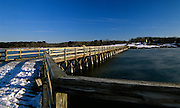 Long wooden wharf / pier at Fort Foster, which is an old Military base located in Kittery, Maine USA, in Portsmouth Harbor, which is part of the New England seacoast.