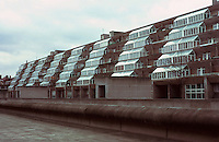 London:  Brunswick Centre--terraced apartments, 1962.  Glazed living room extension for each flat.  Photo '90.